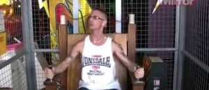 MAN TRIES ELECTRIC CHAIR AT FAIR